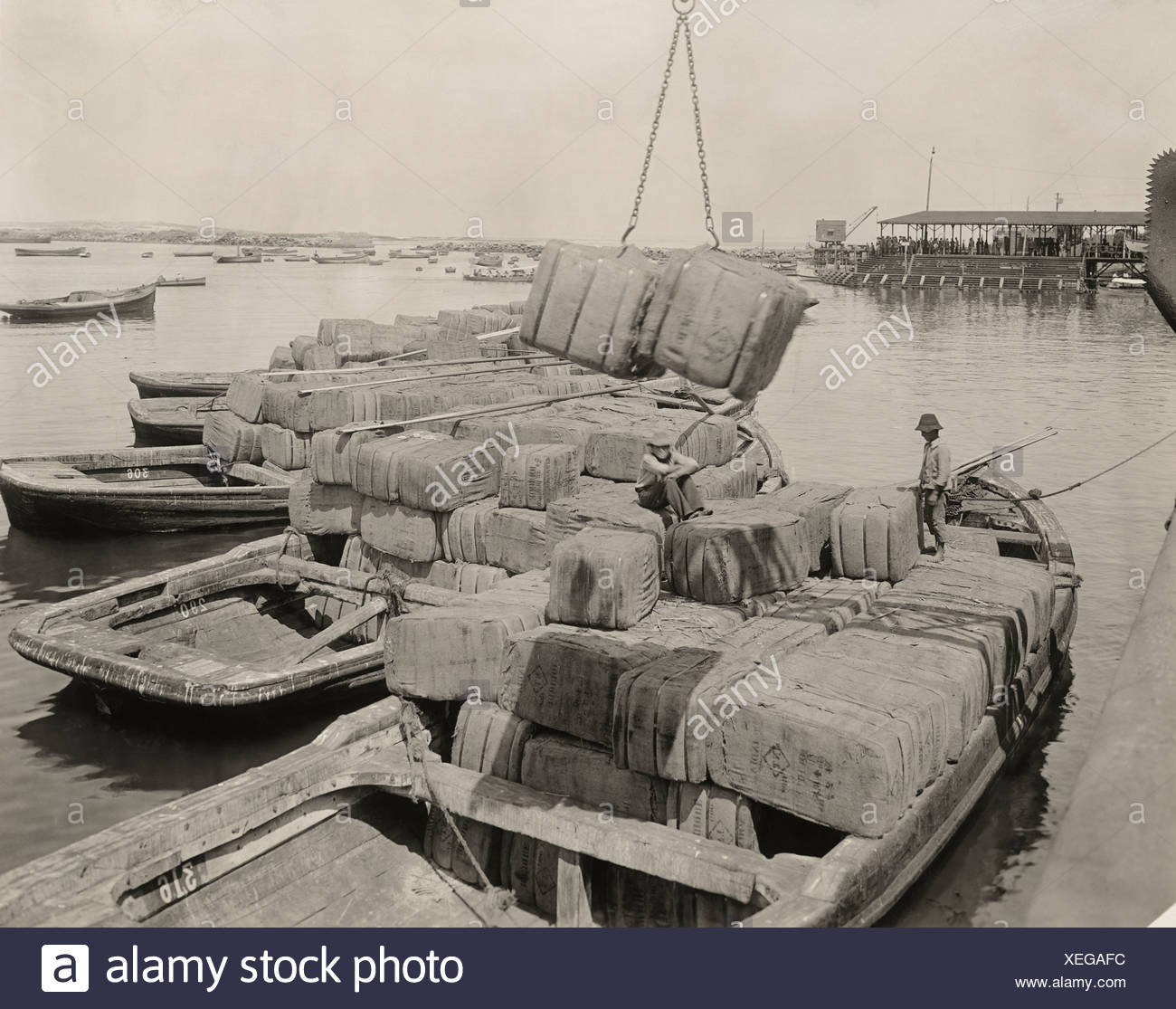 Bales of jute bags arrive from India for the Nitrate fields by ship. - Stock Image