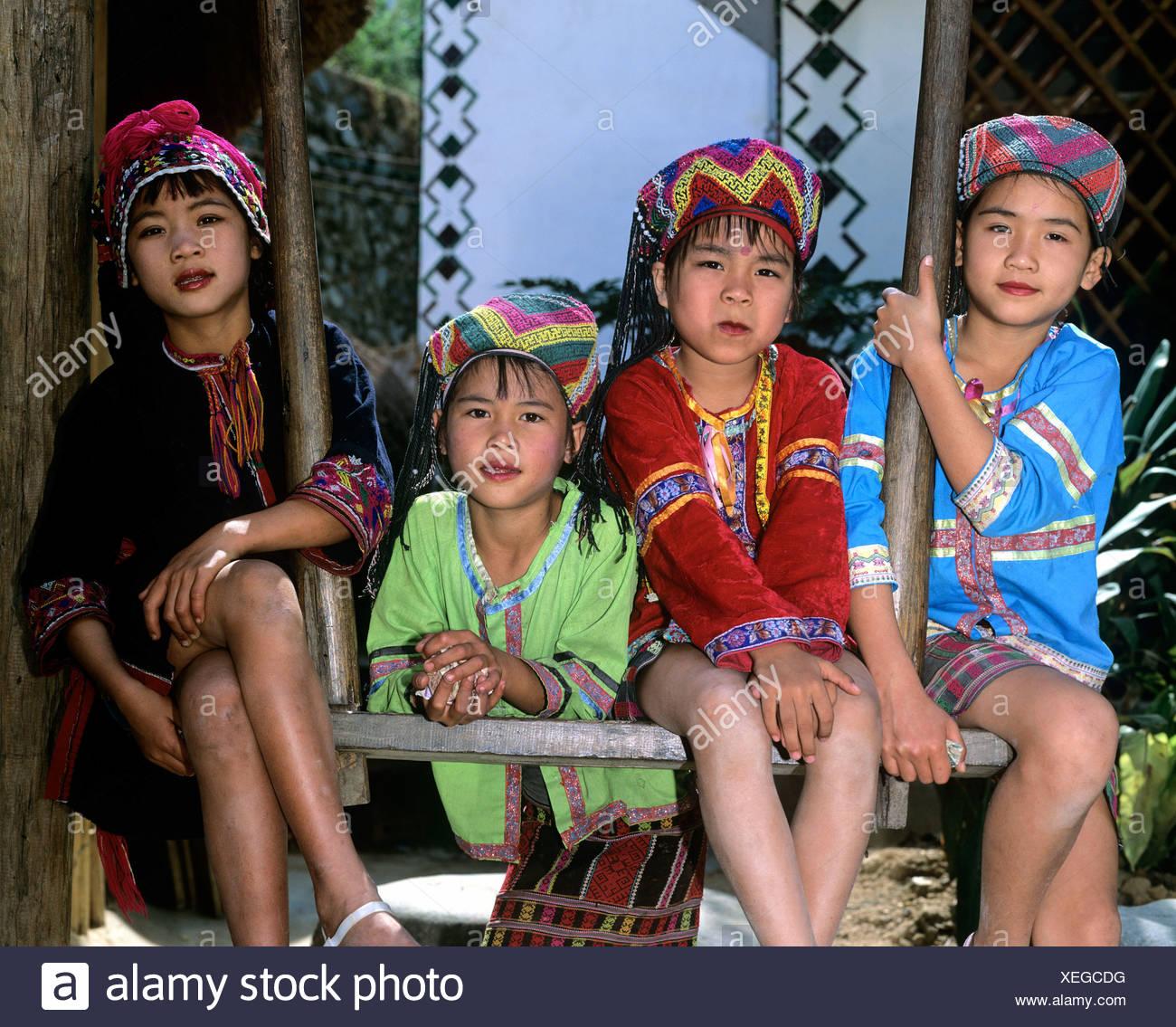 Miao children wearing traditional ethnic costumes Hainan China Asia  sc 1 st  Alamy & Miao children wearing traditional ethnic costumes Hainan China ...