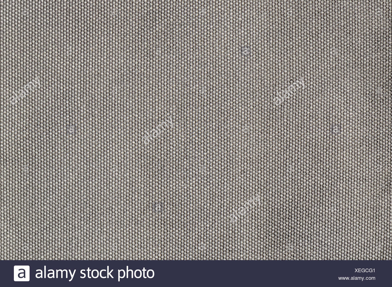close up gray grained cotton background - Stock Image