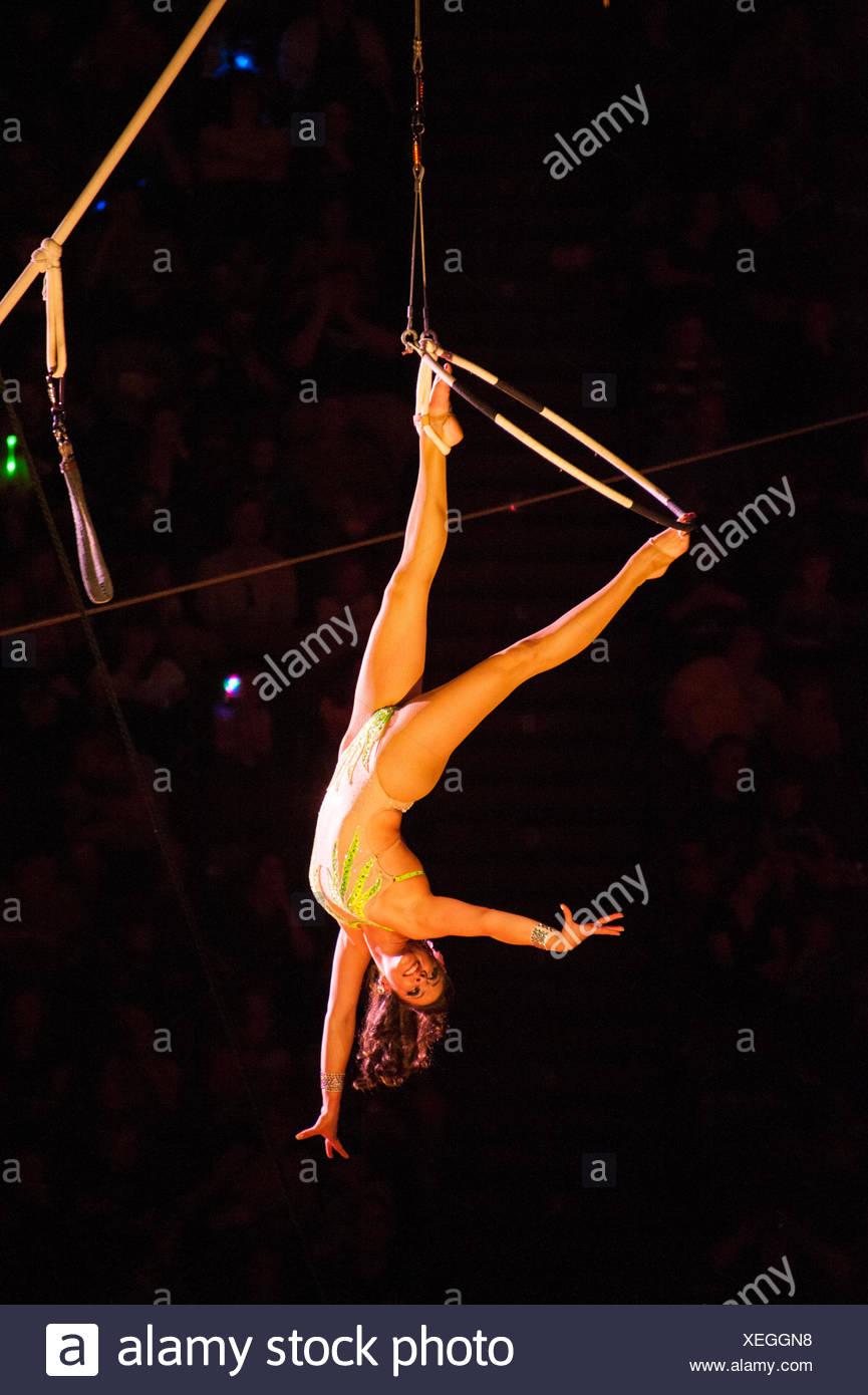 A daredevil acrobat performs at a circus. - Stock Image