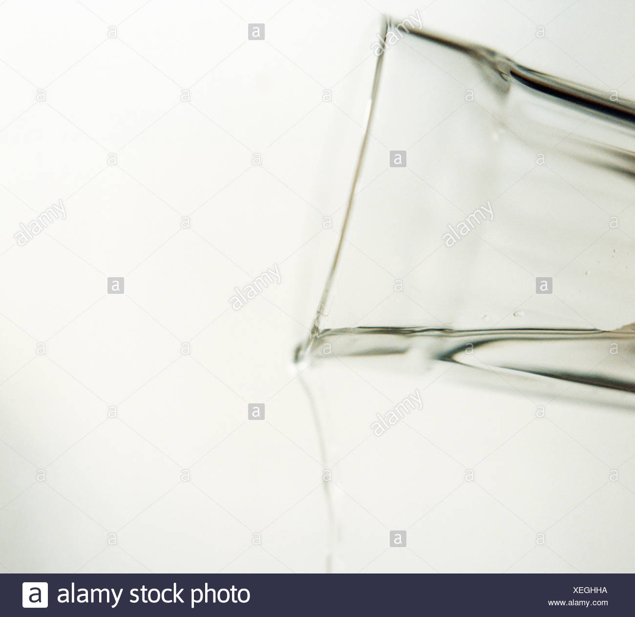 Water being poured out of glass - Stock Image