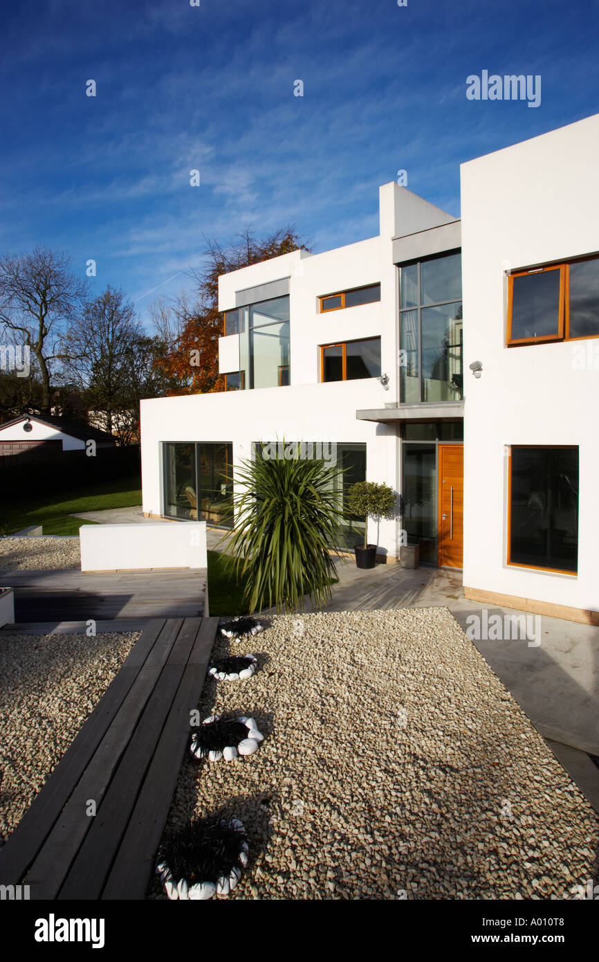 modern art deco style house with white gravel garden and large ...