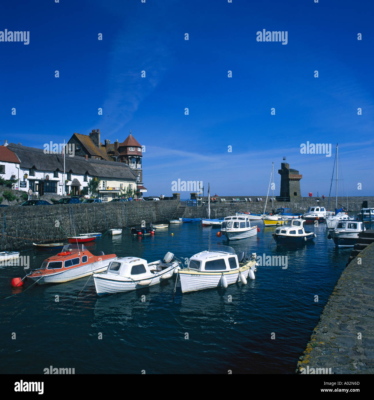 summer view of small boats at anchor in lynmouth harbour with