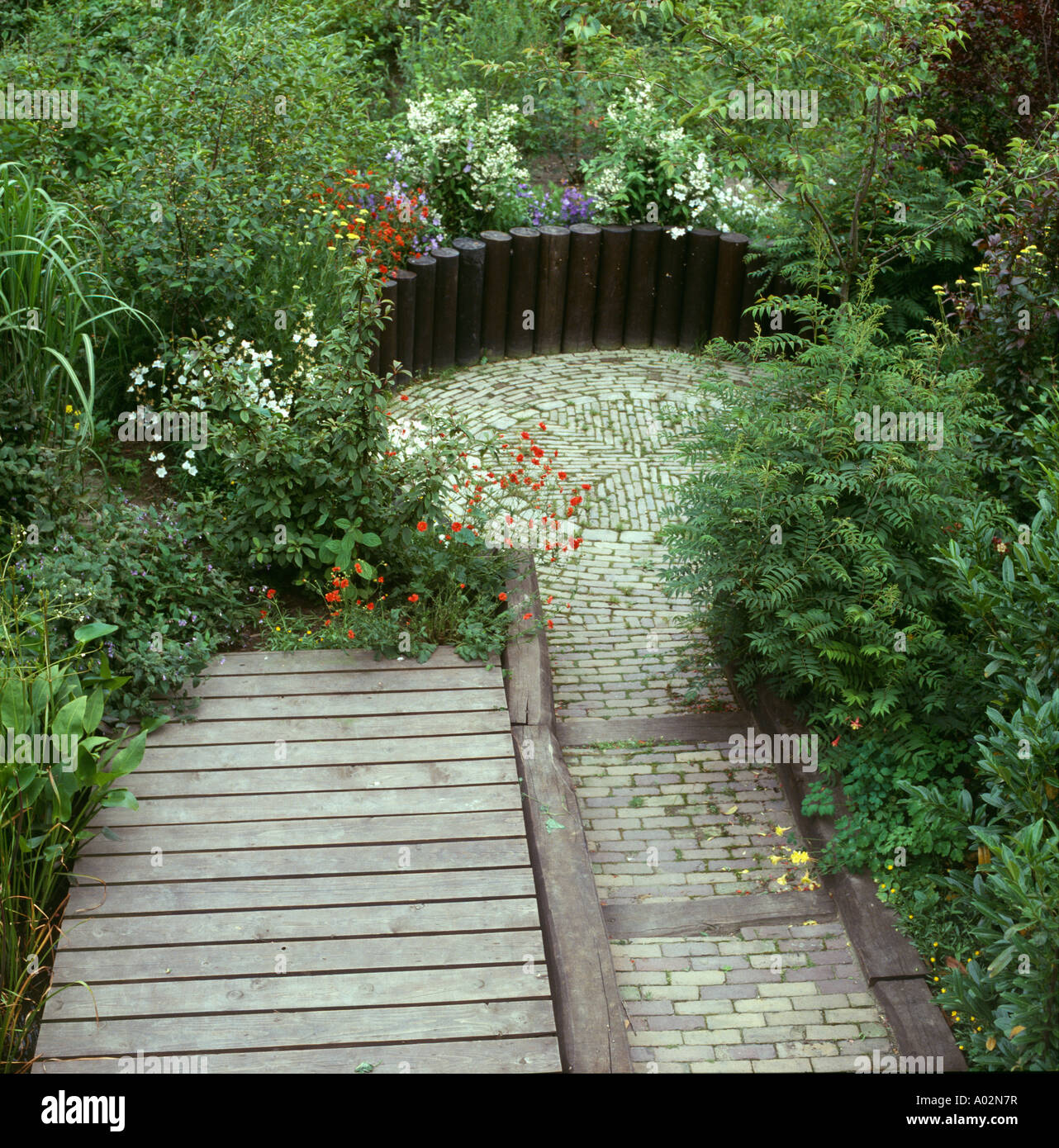 Paving And Wooden Decking Path To Sunken Patio   Stock Image