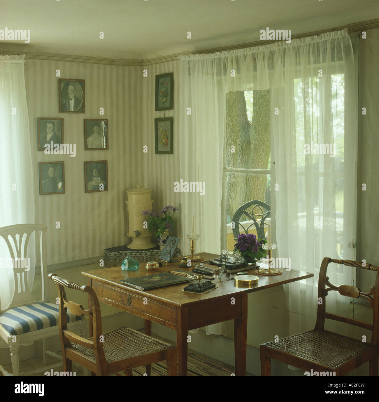 Antique Furniture In Dining Room With Wallpaper And White Voile Curtains