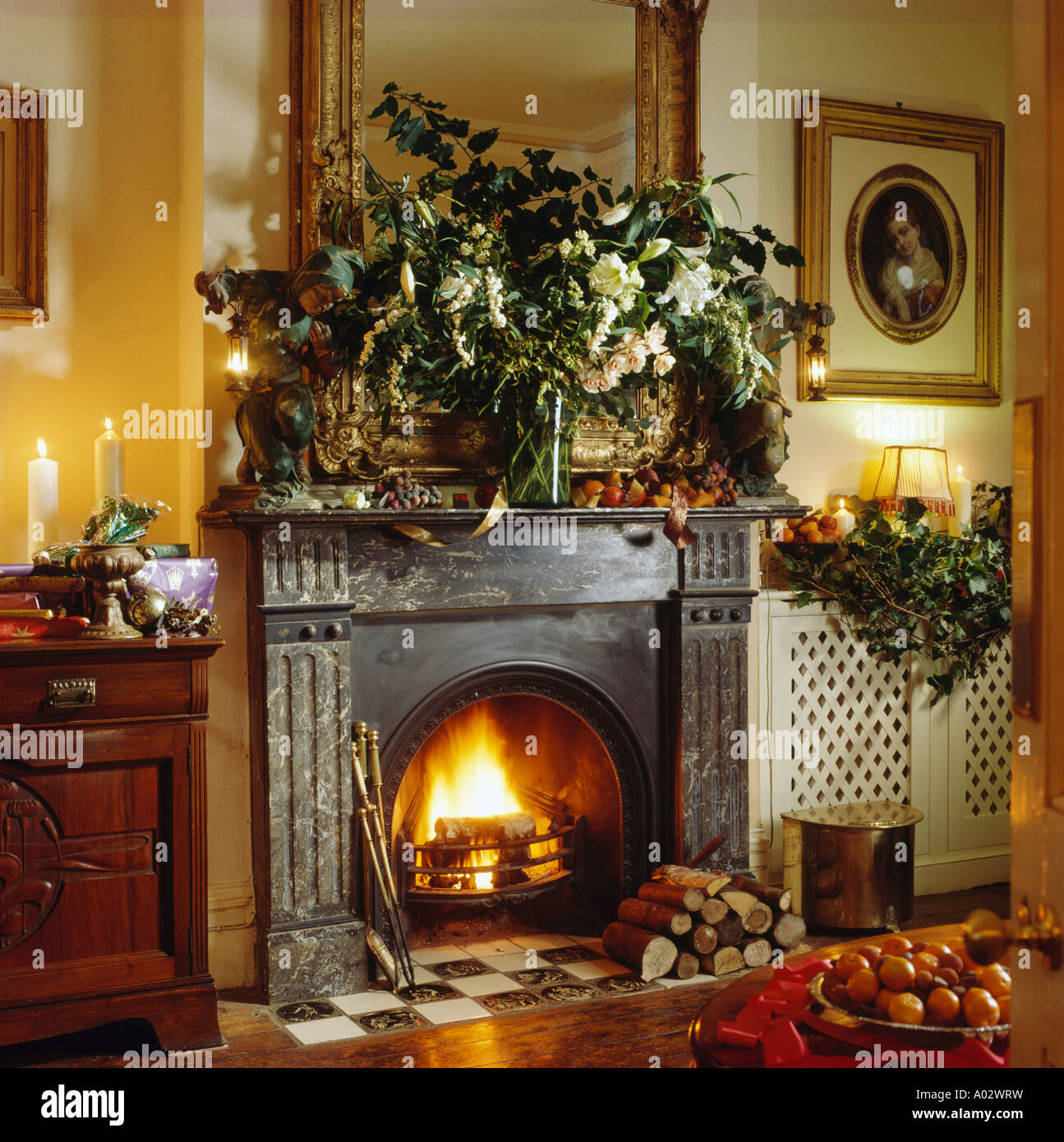 Cast-iron traditional fireplace in Christmas livingroom with lit ...