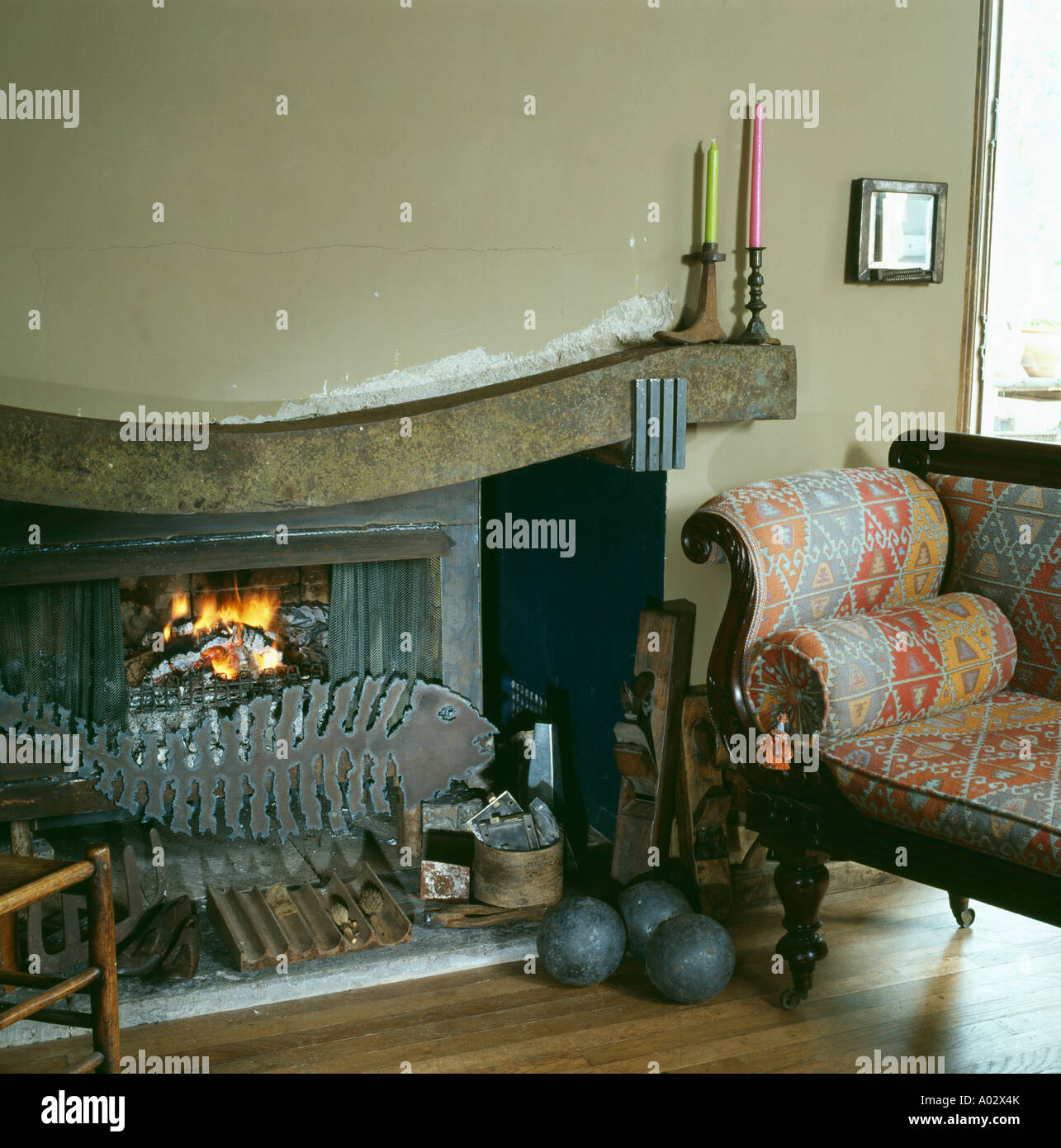cottage livingroom with traditional sofa beside fireplace with