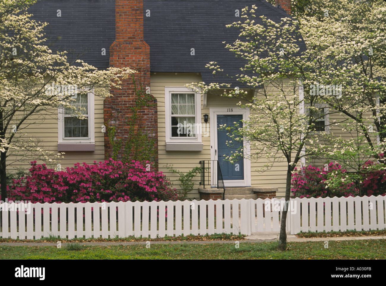 Front Garden Of Traditional House With Picket Fence And