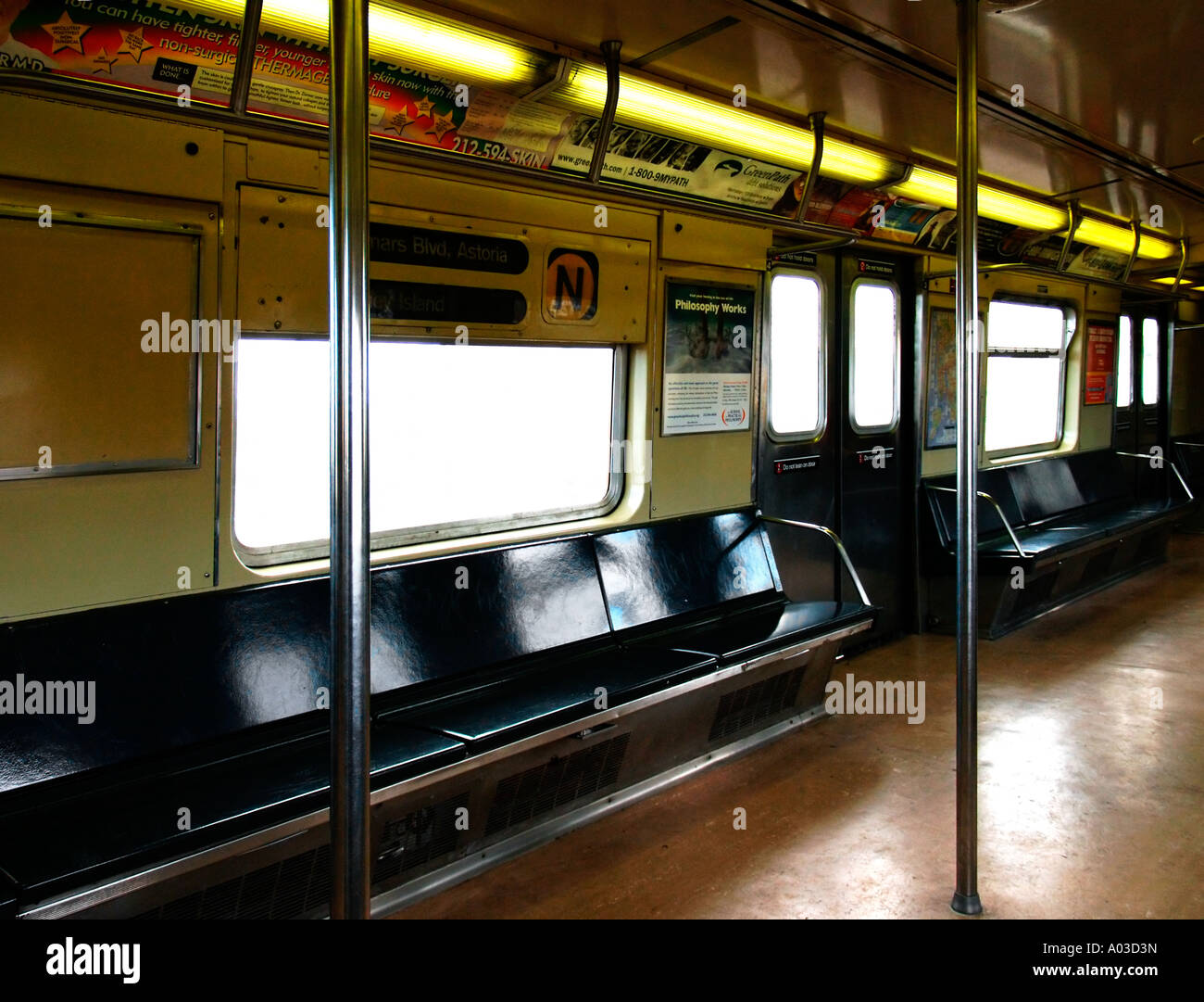 interior of an empty new york city subway n train with light stock photo royalty free image. Black Bedroom Furniture Sets. Home Design Ideas