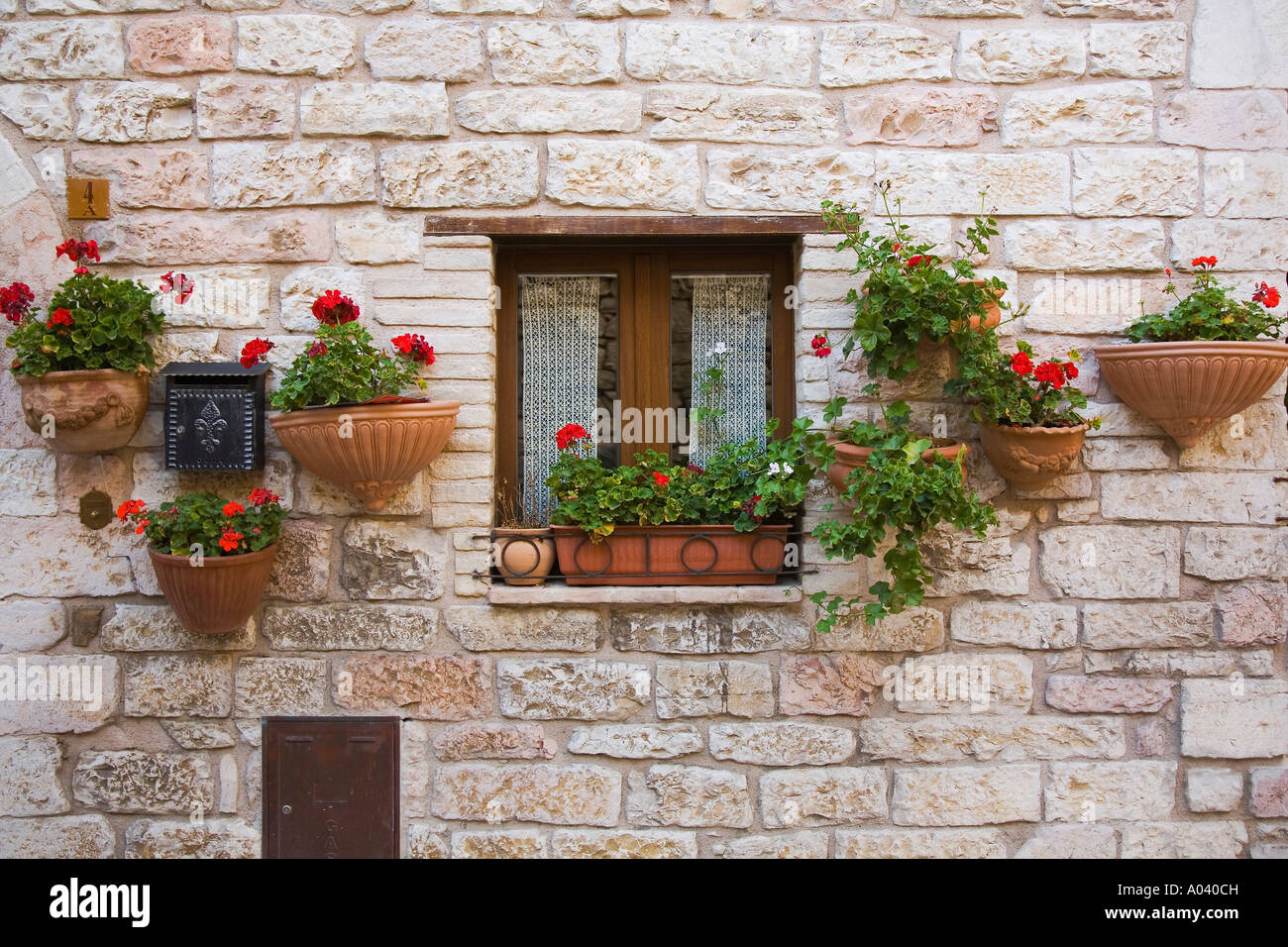 terracotta flower pots and window box with red geraniums on stone stock photo royalty free. Black Bedroom Furniture Sets. Home Design Ideas