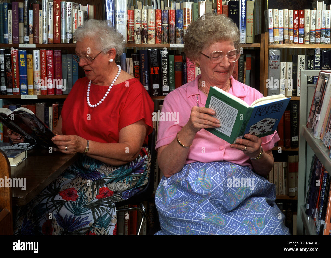 Cool Two Senior Women Reading Books In Library In Their 80S Stock Photo Hairstyles For Women Draintrainus