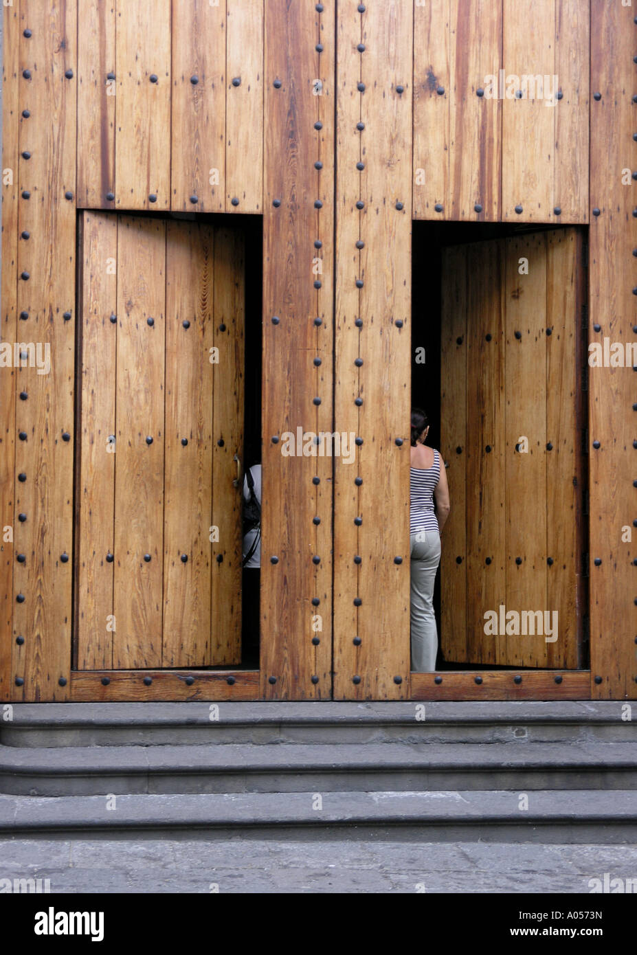 Large Wooden Doors With People Walking Through Into The Church In Agaete Gran Canaria Spain