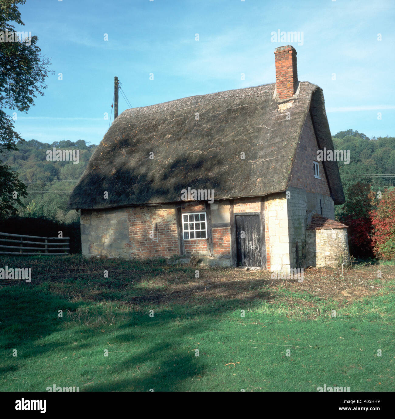 small run down old thatched cottage stock photo royalty free