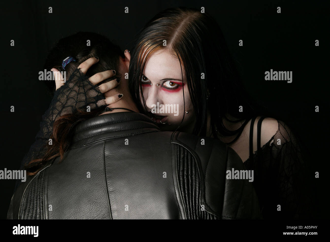 Gothic Girl Love Bites Man In The Side Of His Neck Like A Vampire