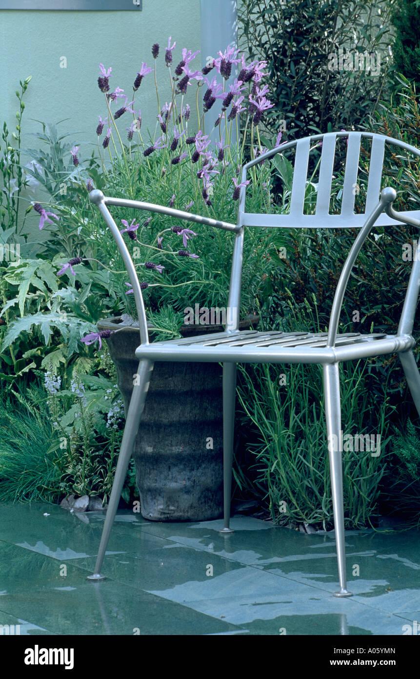 White metal garden chairs - Stock Photo White Metal Garden Chair In Front Of Lavendula Stoechas In Pots