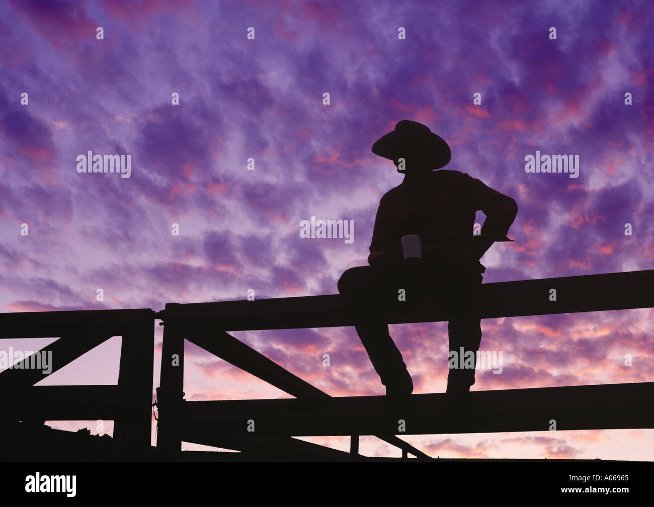 Usa Silhouette Of Western Rodeo Cowboy Sitting On Fence