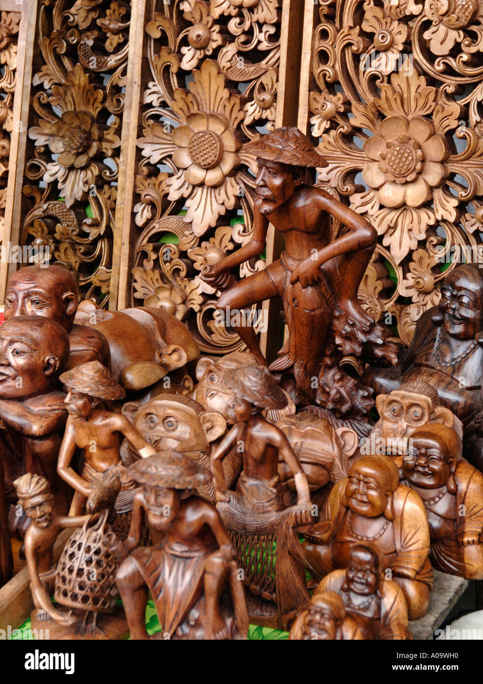Ubud market stall with wooden carvings for sale bali