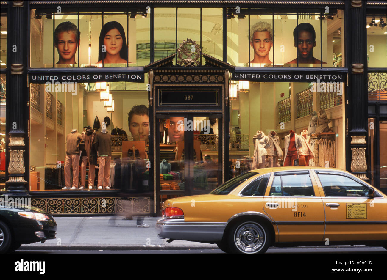 Yellow cab parking in front of benetton showcase on fifth for Benetton usa online shop