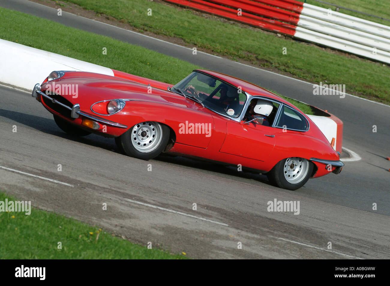 Jaguar driving gloves uk - Red Jaguar E Type Classic Sports Car On Race Track In The Uk Stock Image