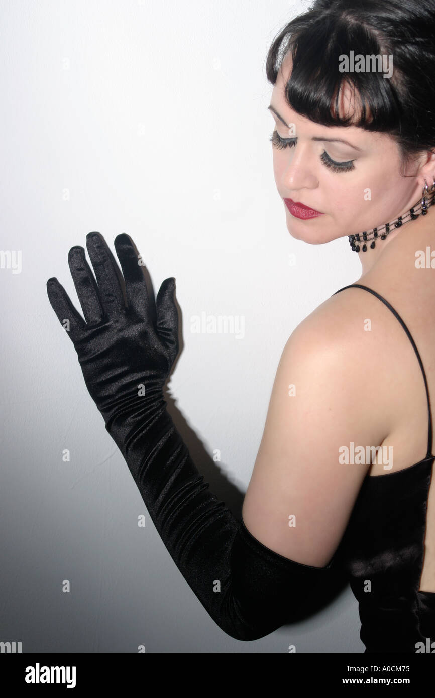Black gloves for gown - Stock Photo Noir Style Studio Portrait Of Brunette With Black Opera Gloves In Satin Gown