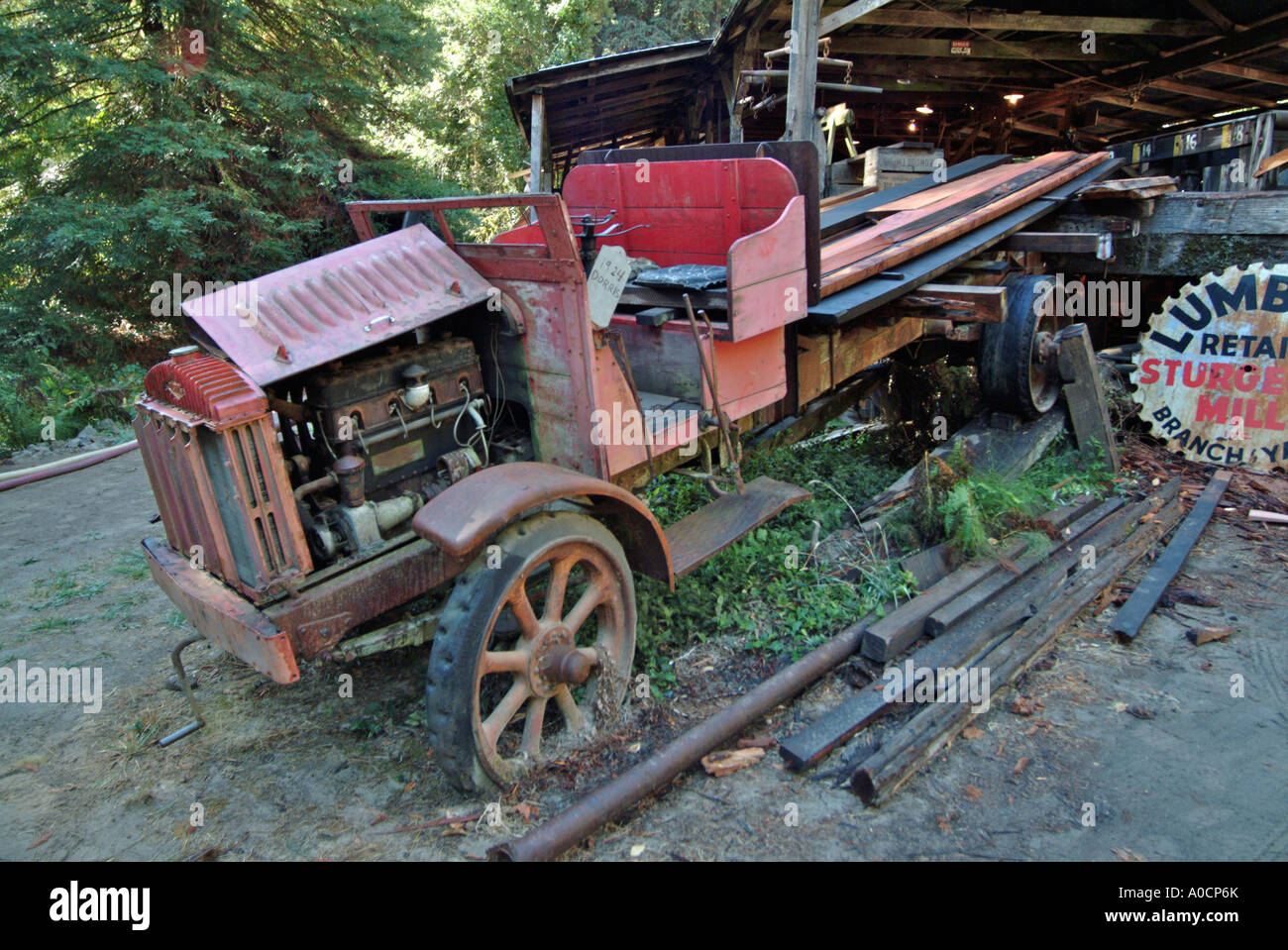An old dusty antique red 1924 Dorris flatbed truck used as a ...