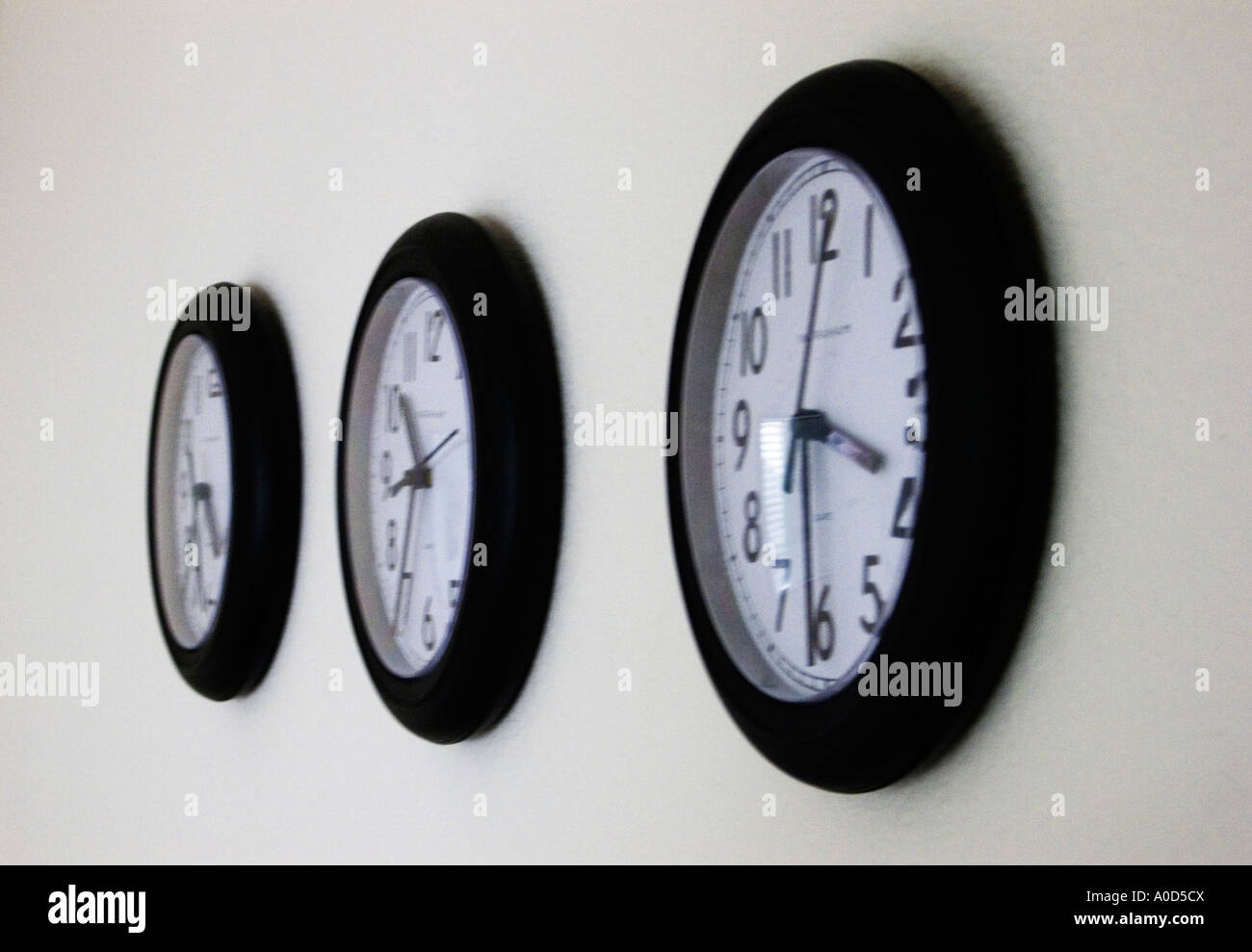 three office wall clocks set at different times stock photo  - stock photo  three office wall clocks set at different times