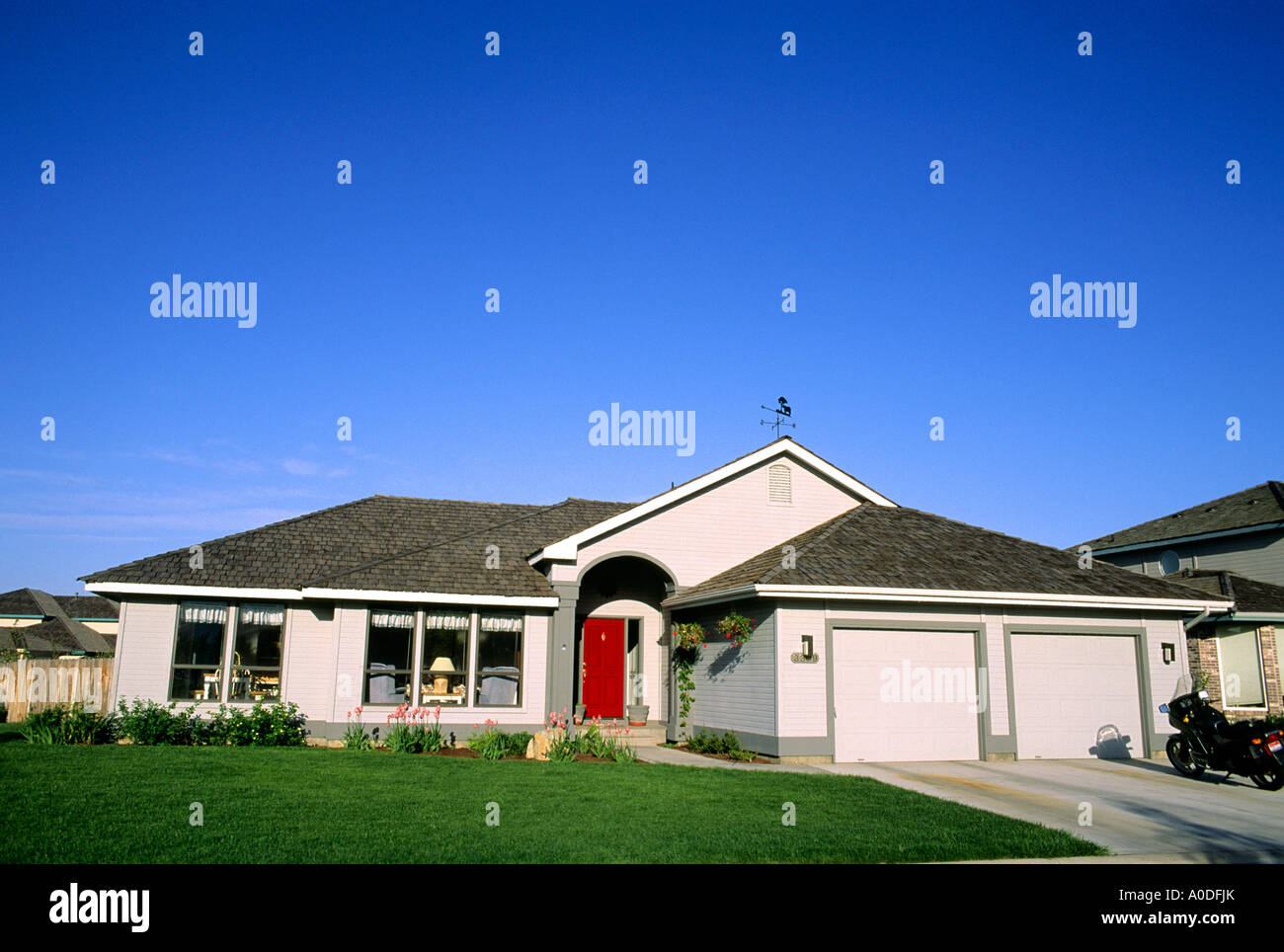 ranch style house with a two car garage stock photo royalty free