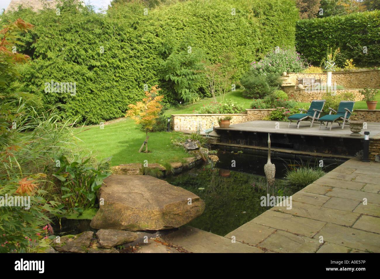 Seating Area Around Pond In Modern Mediterranean Style: Modern Style Garden Pond And Wood Decking Seating Area