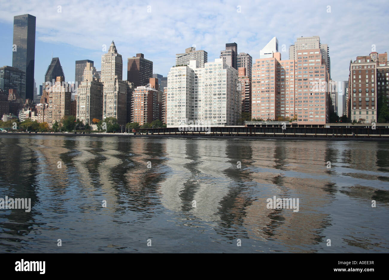 midtown manhattan skyline including trump world tower reflected in
