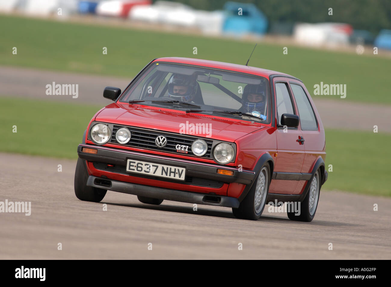 red mark 2 volkswagen golf gti 16v car racing on a circuit in the uk stock photo royalty free. Black Bedroom Furniture Sets. Home Design Ideas