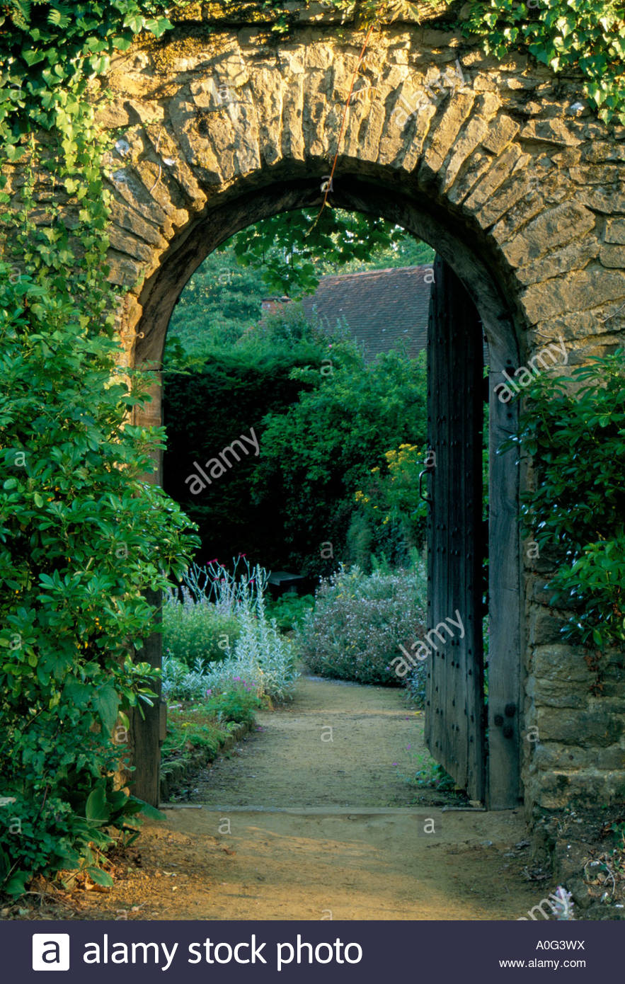 Munstead Wood Surrey Garden Door In Stone Wall Leading Through To