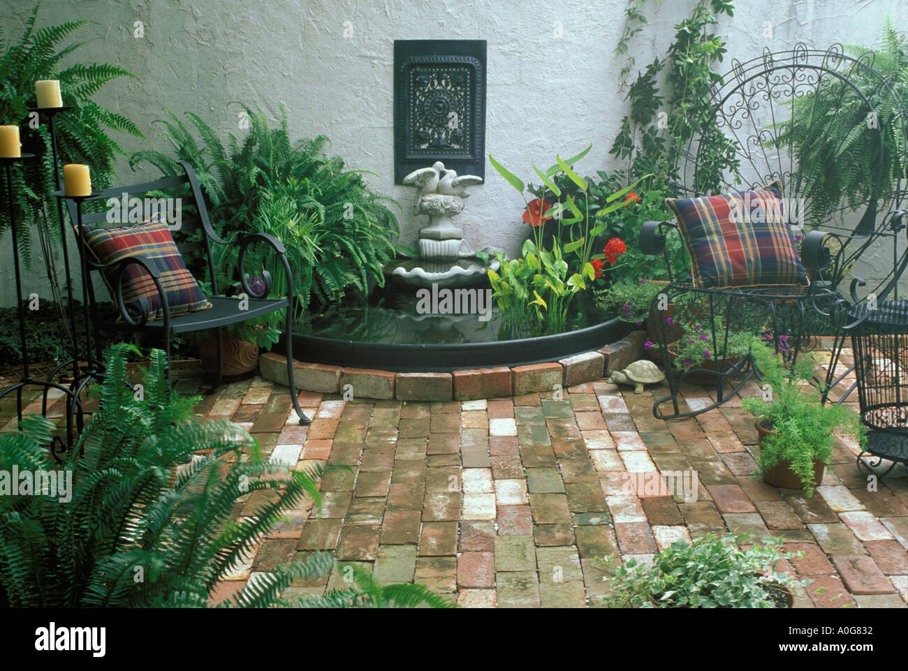 private enclosed brick courtyard with stucco wall, decorative pool