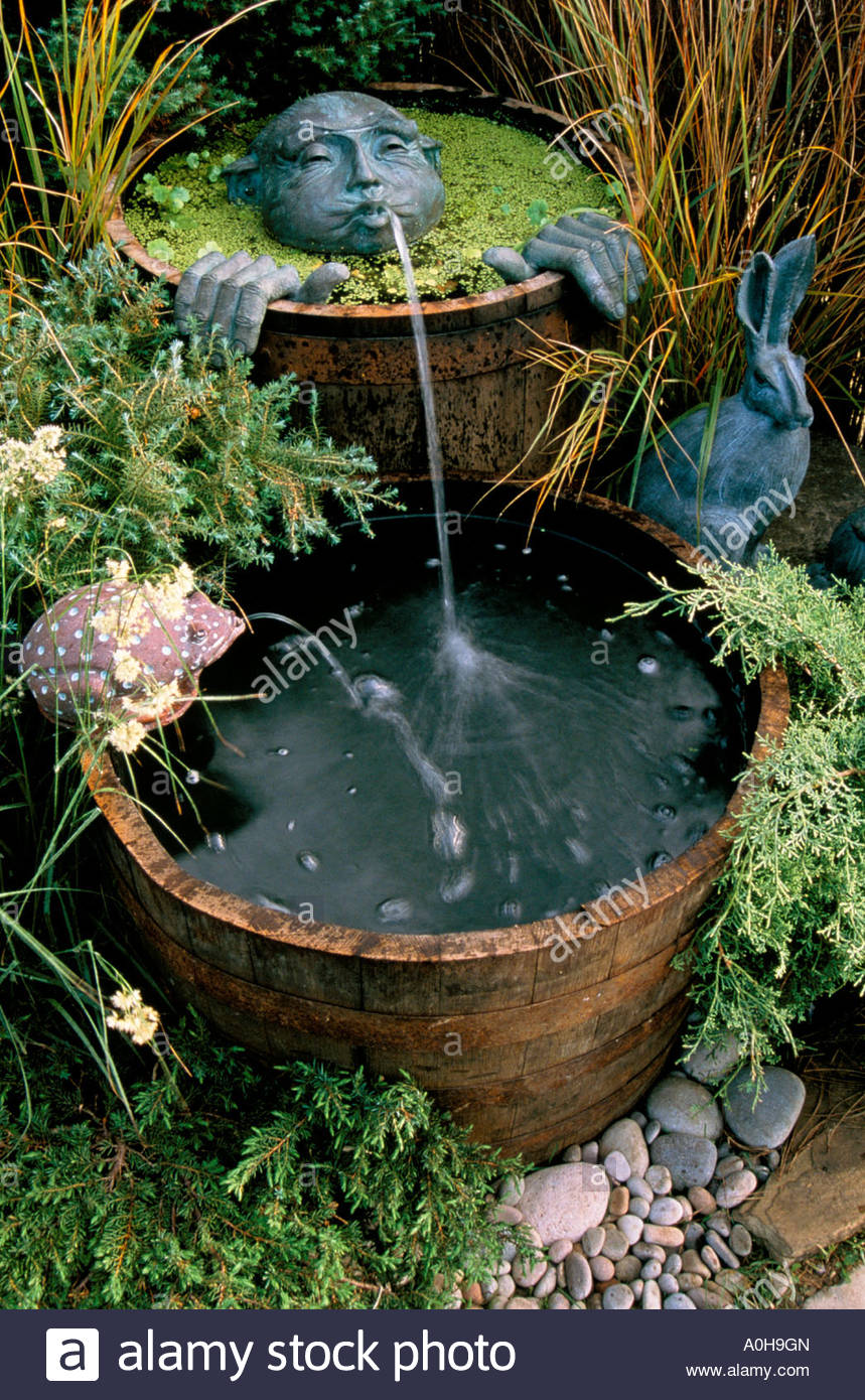Two wooden half barrel pond water features with amusing for Pond water features