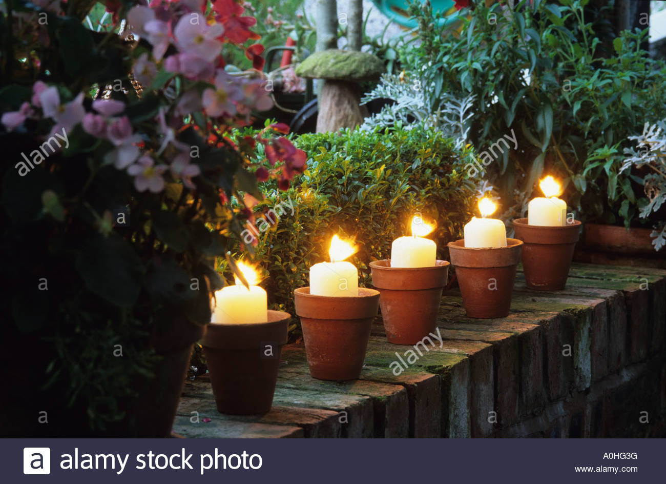 Garden Candle Wall Lights : Woodside Rd. Chester. Garden Lighting. Candles in pots on garden Stock Photo, Royalty Free Image ...