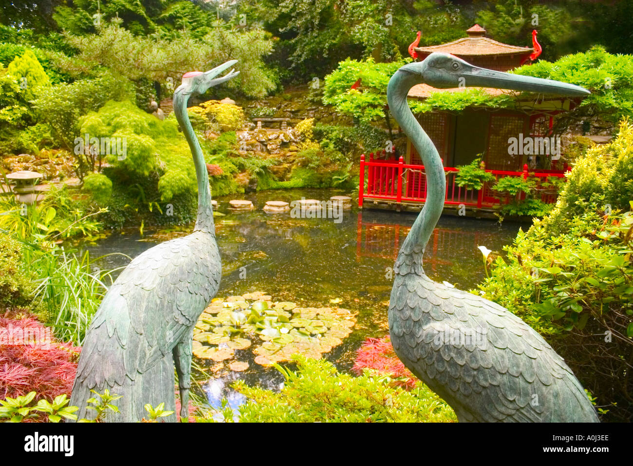 storks in japanese garden ornaments pond flowers water