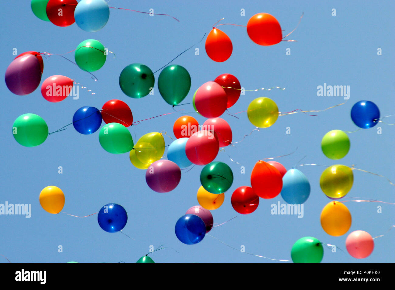 festive coloured balloons in a blue sky stock photo royalty free