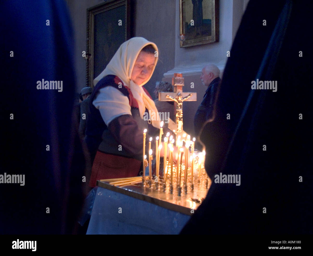 stock photo women lighting candels at an alter in the orthodox church of the holy spirit vilnius lithuania alter lighting