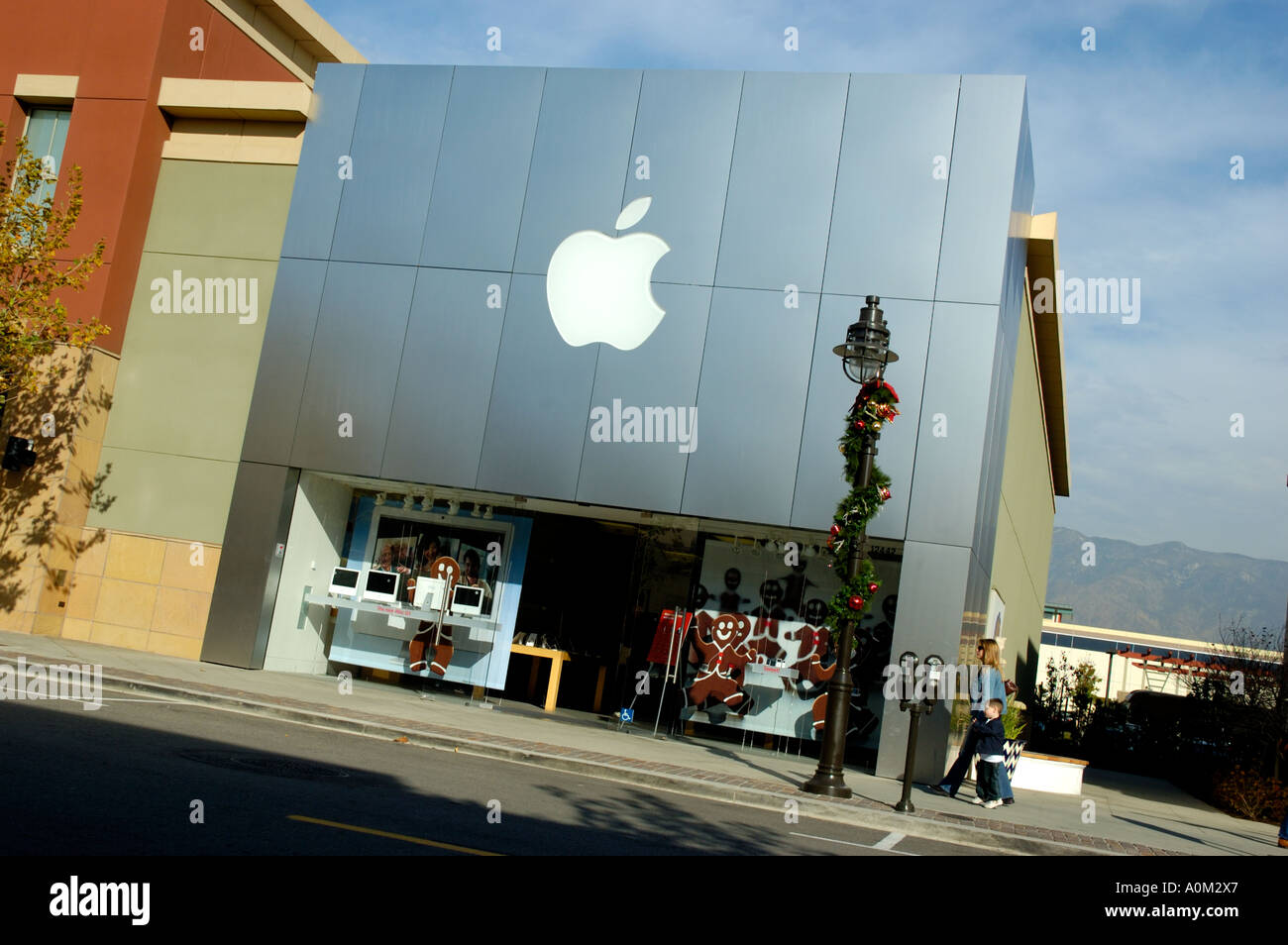 Apple Store Facade With Christmas Decorations Lamppost Next To It In Stock Photo Royalty Free