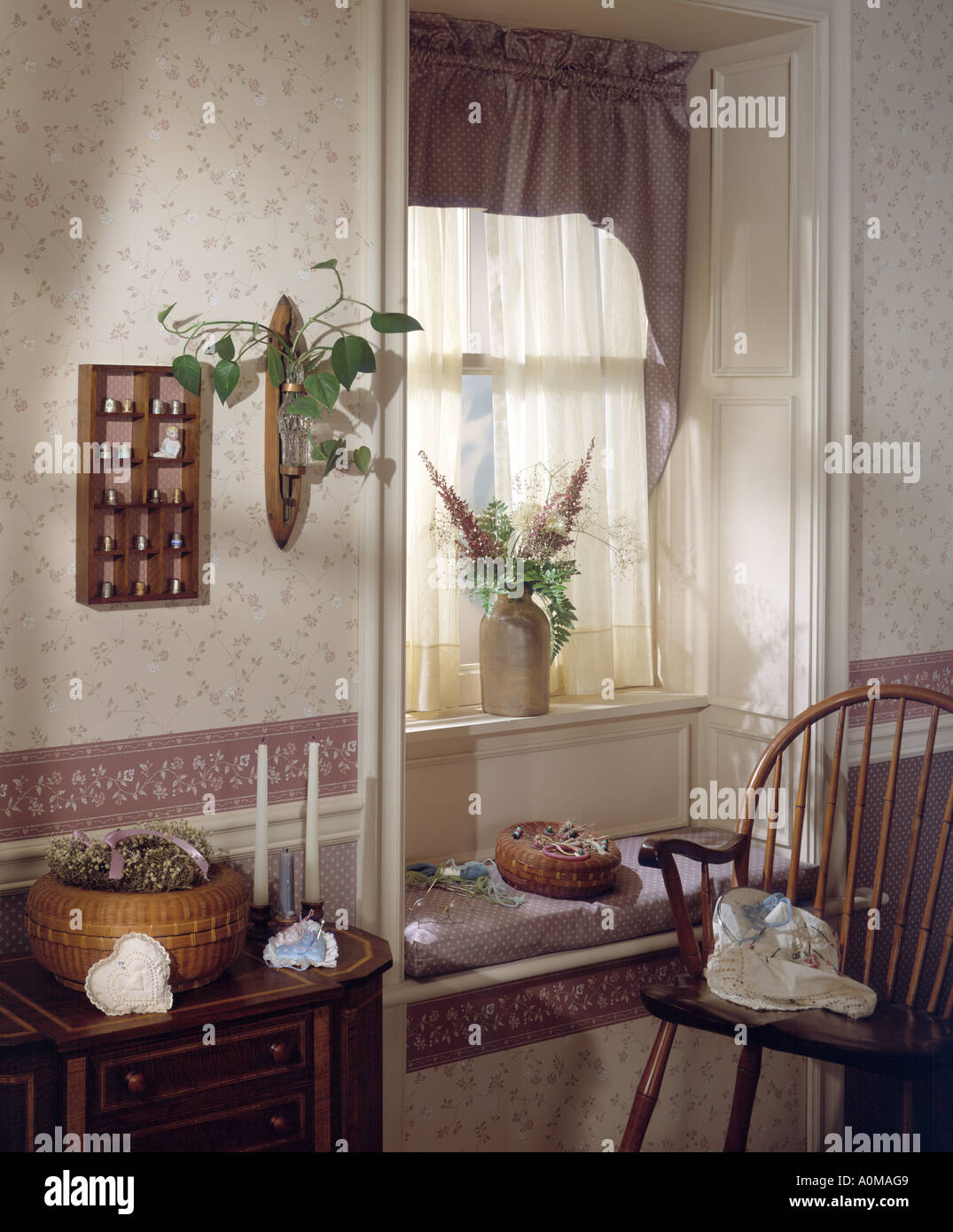 Stock Photo   Room Interior Window Alcove Table Drape Antique Rocker Rug  Sewing Box Objecrs Pillow Thread Window Seat Alcove Candles Thimble C