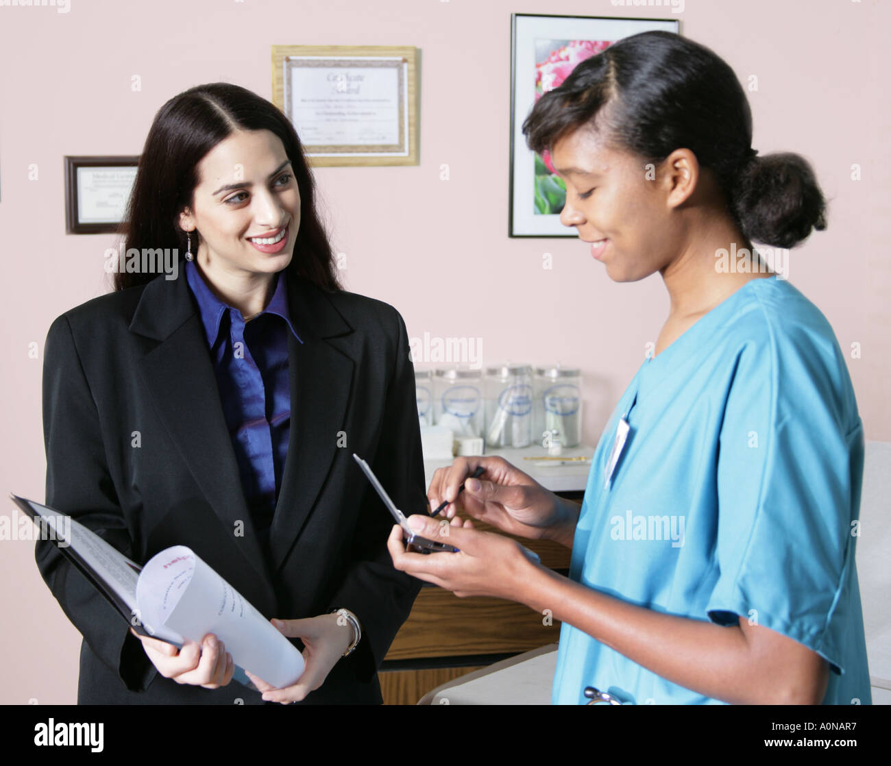 drug rep stock photos drug rep stock images alamy s rep talks and tries to sell services or products to nurse working in