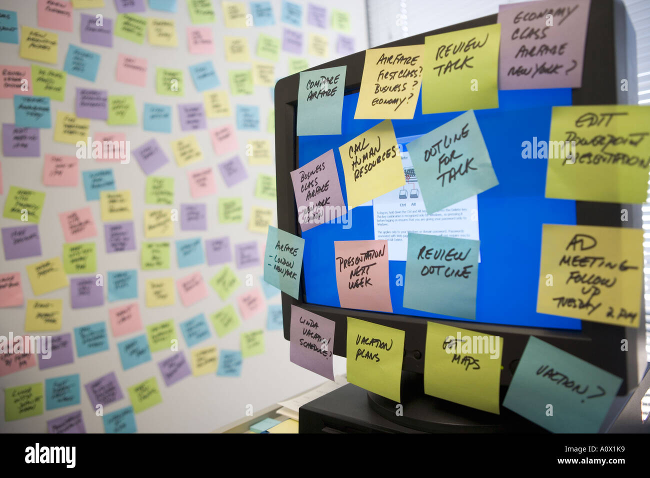 sticky notes fill computer monitor and office wall stock. Black Bedroom Furniture Sets. Home Design Ideas