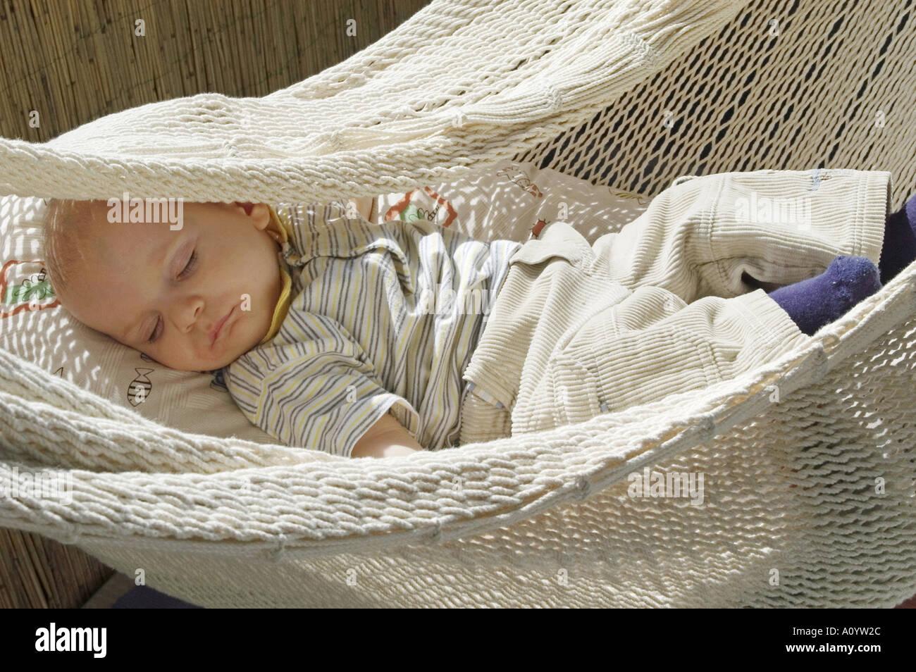 baby sleeping quietly in hammock baby sleeping quietly in hammock stock photo royalty free image      rh   alamy