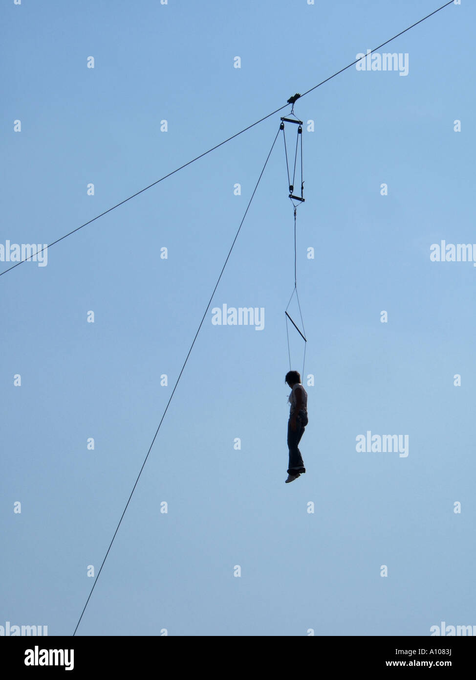 woman entertainer trapeze artist hanging on high wire rope stock stock photo woman entertainer trapeze artist hanging on high wire rope