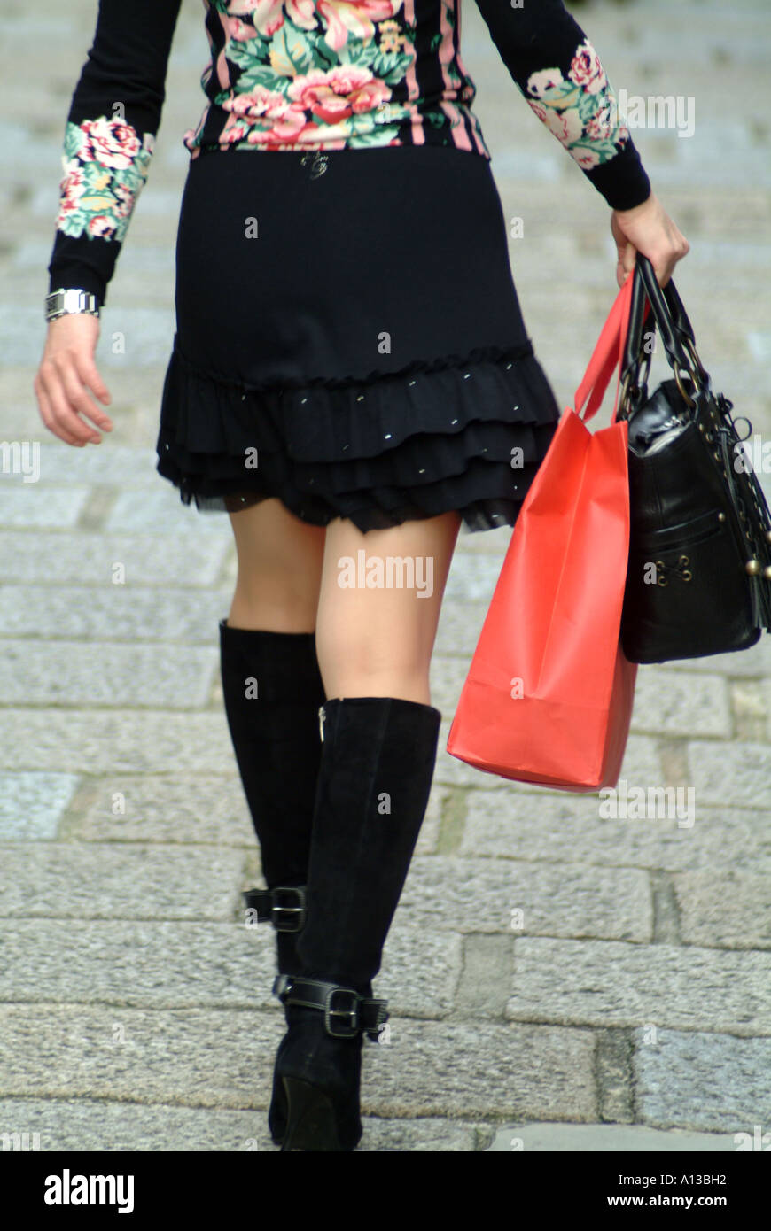 Woman wearing fashionable boots carrying a shopping bag Kyoto ...