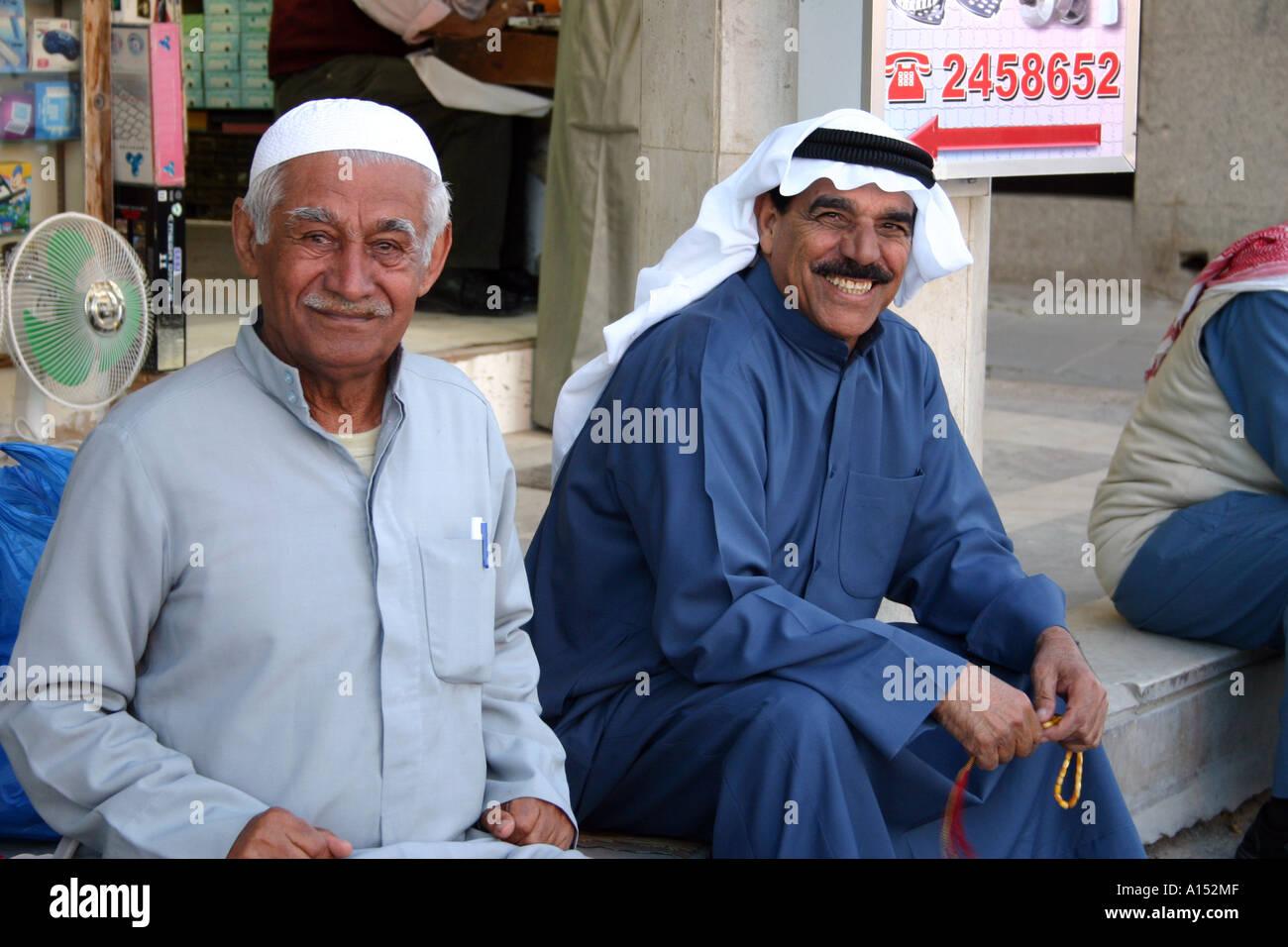 Smiling middle eastern gentlemen dressed in traditional clothing smiling middle eastern gentlemen dressed in traditional clothing kuwait sciox Images