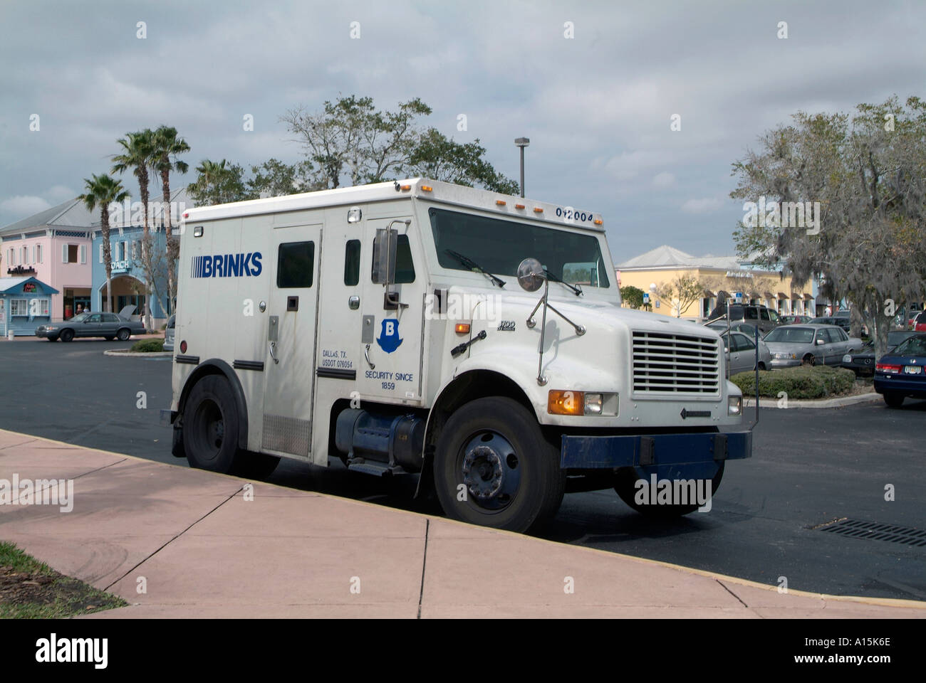 Brinks armored truck outside of tampa florida business picks up deposits from businesses stock image