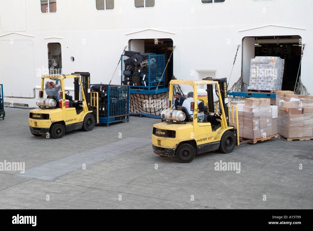 Workers Load Cruise Ship With Supplies With A Fork Lift Truck In - Cruise ship supplies