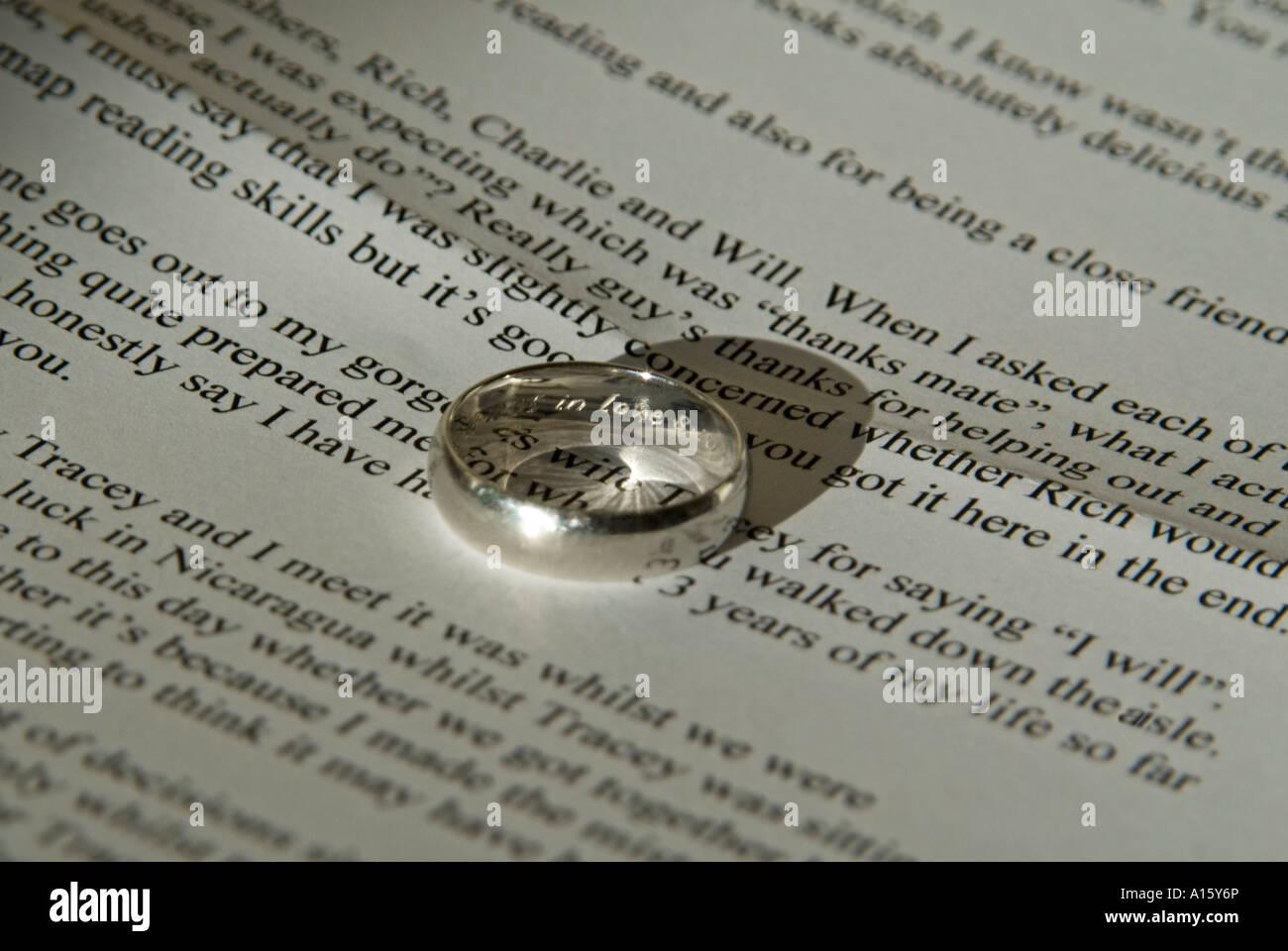 Horizontal close up of a Grooms inscribed platinum wedding ring