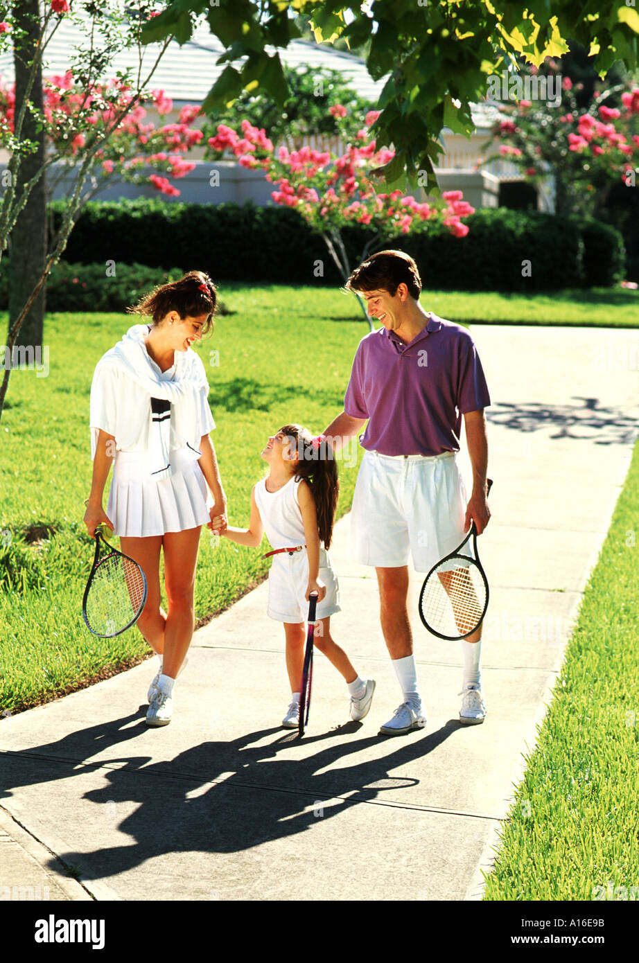 Affluent Hispanic Family Walking Together After Playing Tennis