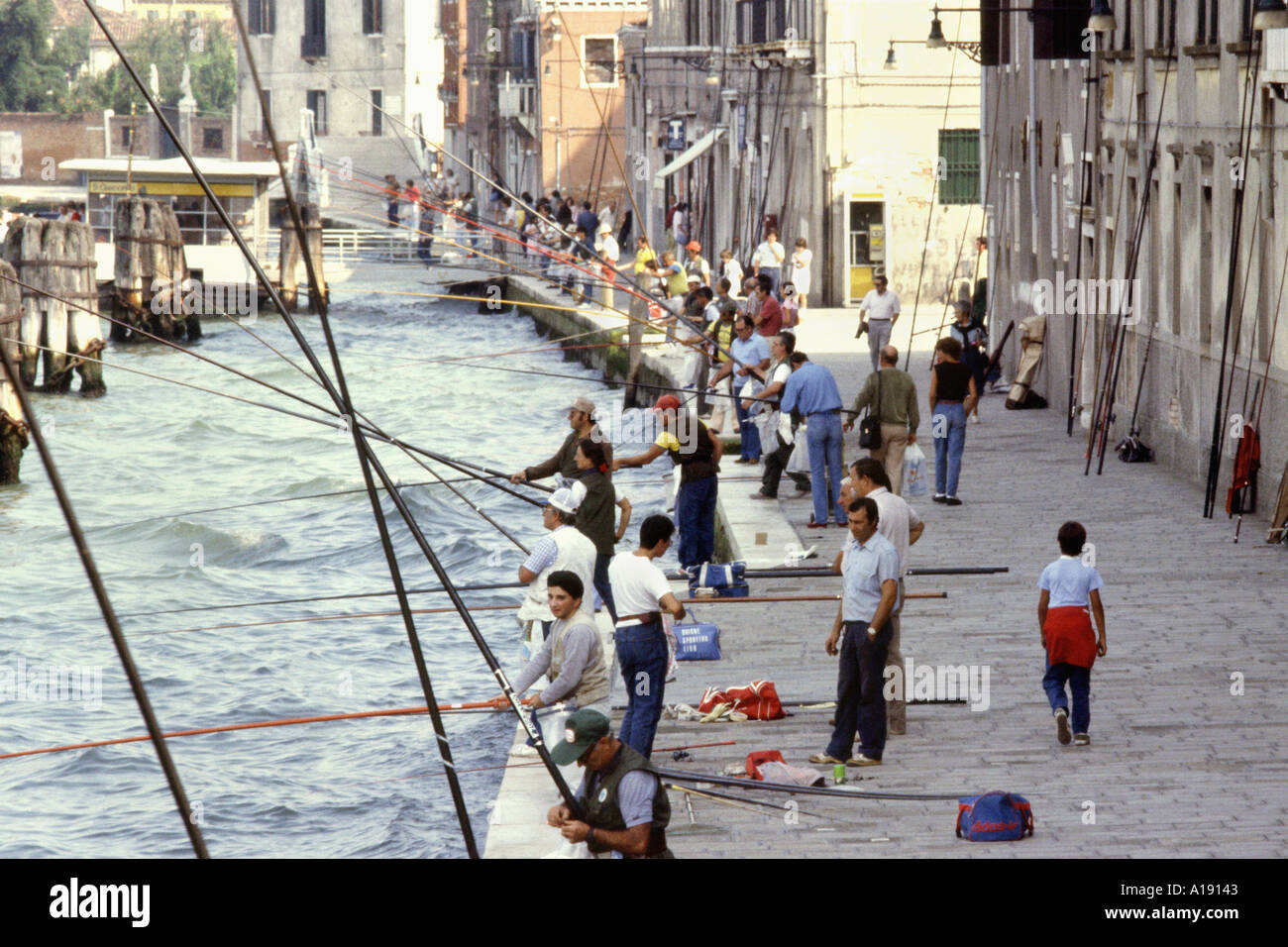 canal fishing venice italy stock photo royalty free